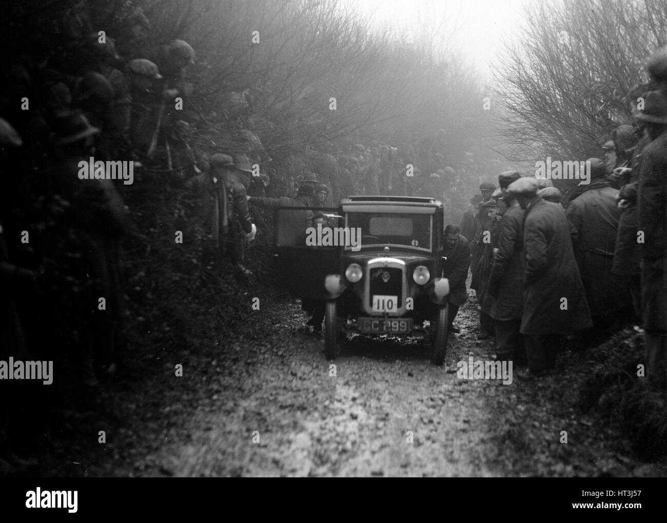 Austin top hat saloon of EC Smyth competing in the MCC Exeter Trial, Meerhay, Dorset, 1930. Artist: Bill Brunell. - Stock Image