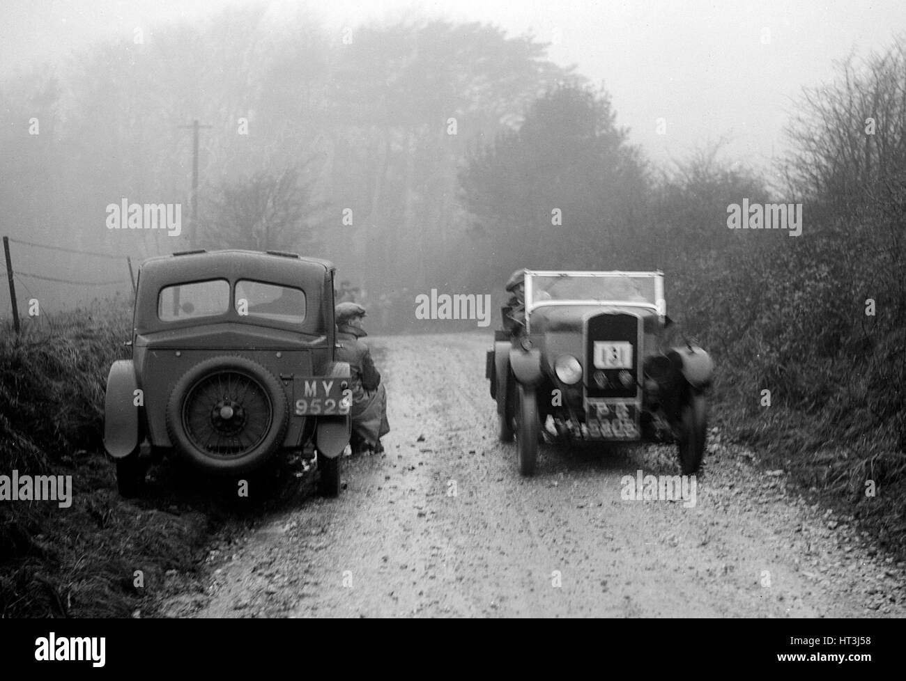 Triumph of J Cramer-Parry passing an official's Riley, MCC Exeter Trial, Blackhill, Dorset, 1930. Artist: Bill Brunell. Stock Photo