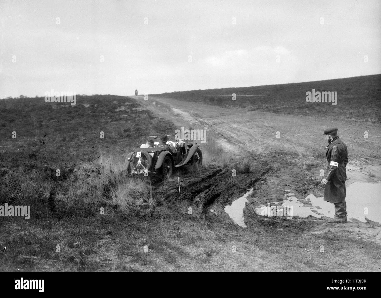 Swept-wing MG J2 competing in a motoring trial, Bagshot Heath, Surrey, 1930s. Artist: Bill Brunell. - Stock Image