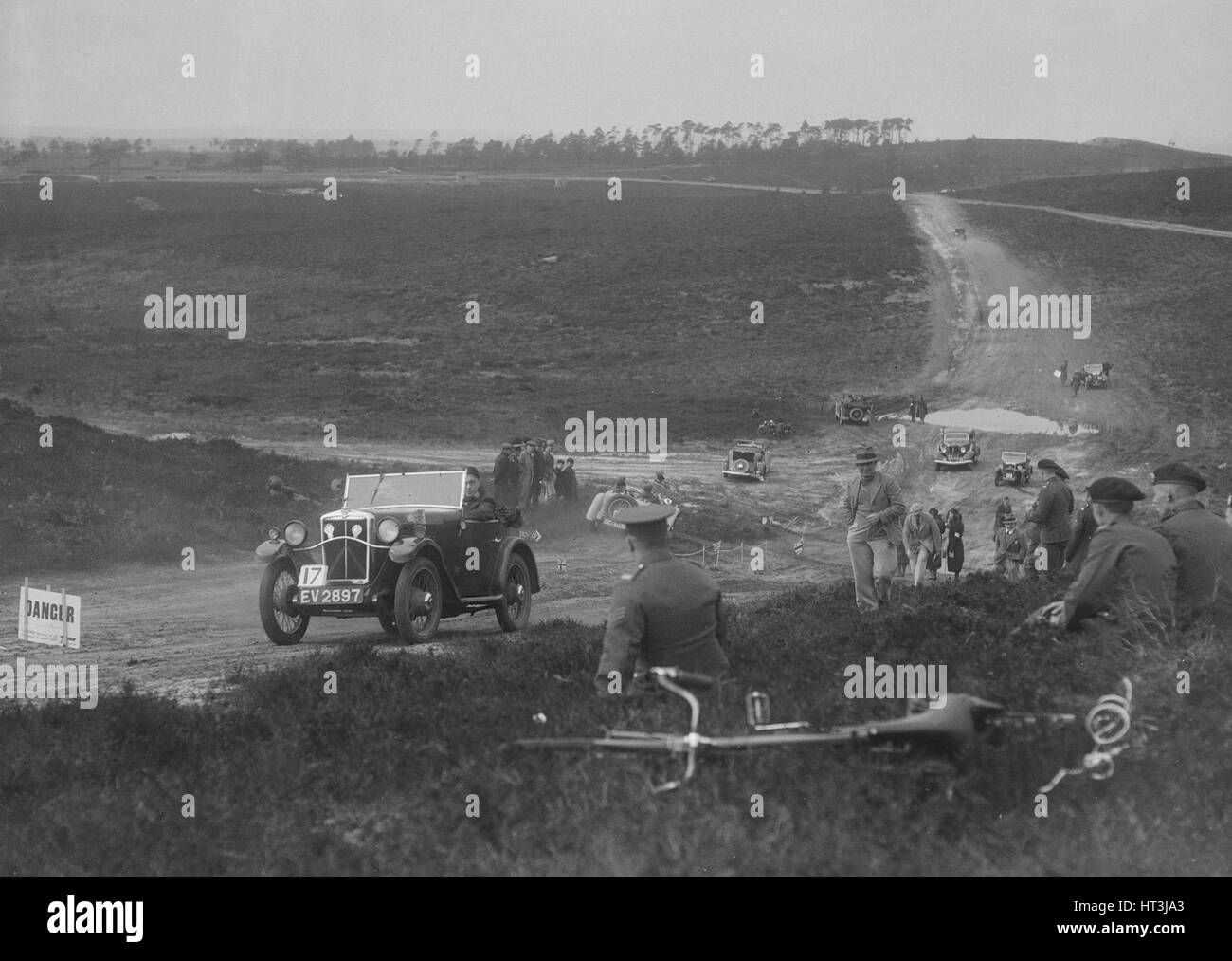 1931 Morris Minor open 2-seater competing in a motoring trial, Bagshot Heath, Surrey, 1930s. Artist: Bill Brunell. - Stock Image