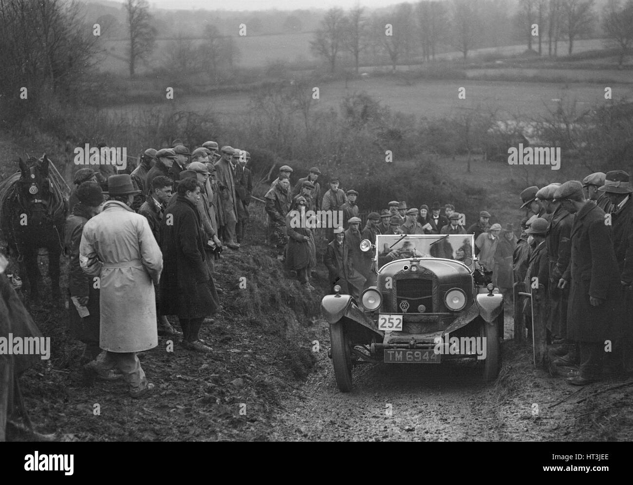 Crossley of HJ Stroud competing in the MCC Exeter Trial, Ibberton Hill, Dorset, 1930. Artist: Bill Brunell. Stock Photo