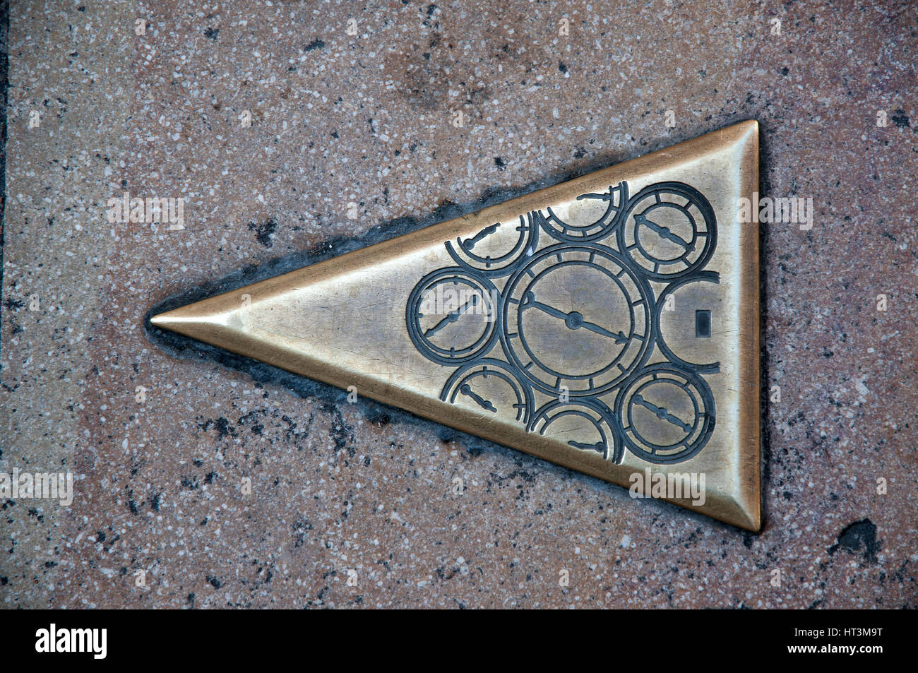 Brass plate in the pavement indicating a city walk in Besancon France showing compass needles - Stock Image