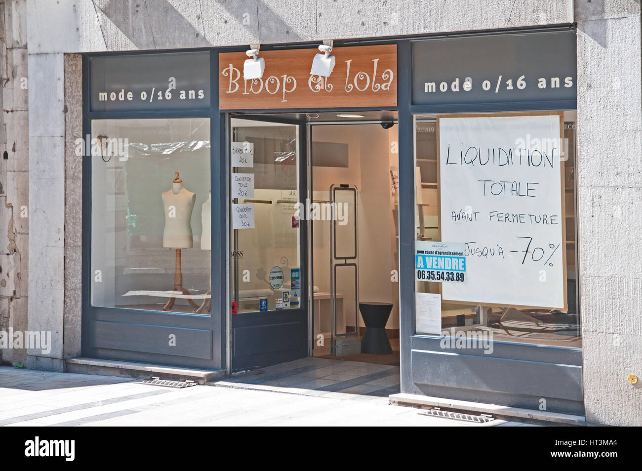 Shop Bloop la Lola closed for liquidation on the Grand Rue   Besancon France with notices reading Liquidation Totale - Stock Image