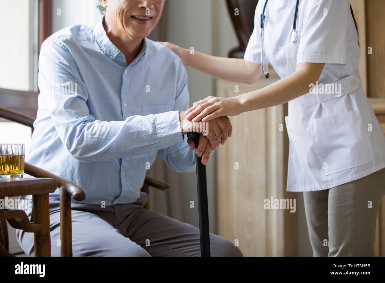 Nursing Assistant Holding Hand Senior Stock Photos & Nursing ...