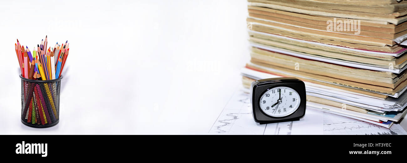 Old books with clock. - Stock Image