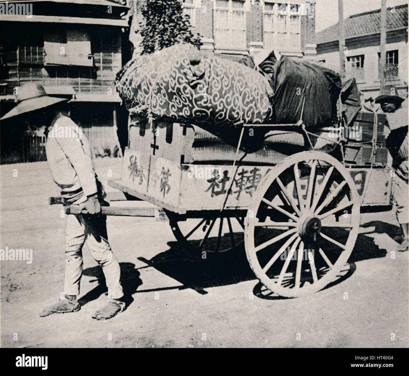 'The Japanese are not slave to possessions. Most can move house by hand-cart', c1900, (1921).  Artist: Julian - Stock Image