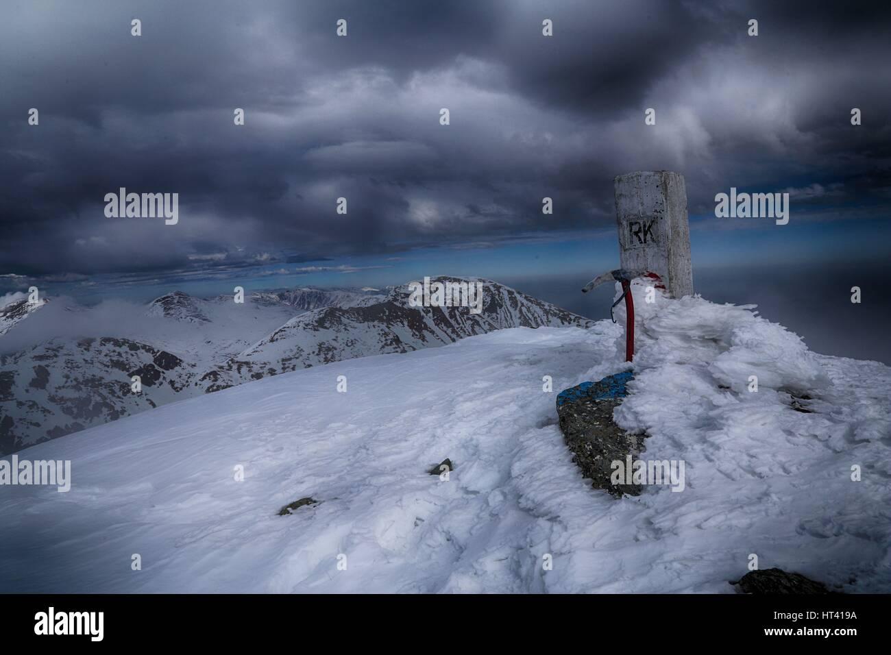 Ice axe on top of Rudoka / Maja e Njeriut the highest peak of Kosovo on the border with Macedonia - Stock Image