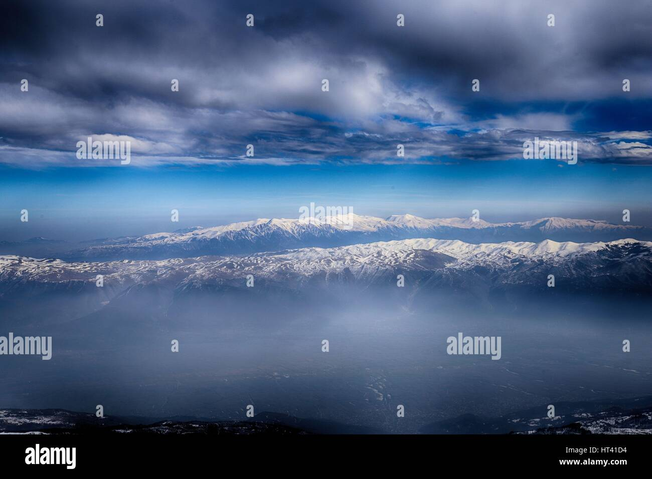 Mountain ranges of Macedonia seen from Sar /Sharr Mountains / Malet e Sharrit between Macedonia and Kosovo in winter - Stock Image