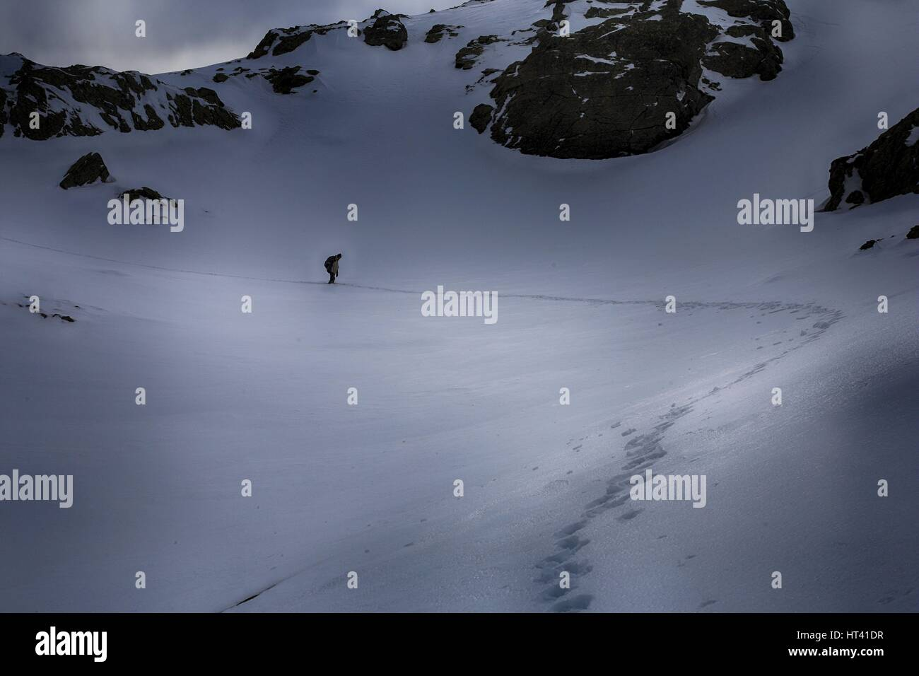 Sar / Sharr Mountains / Malet e Sharrit between Macedonia and Kosovo in winter with climber at the highest peak - Stock Image