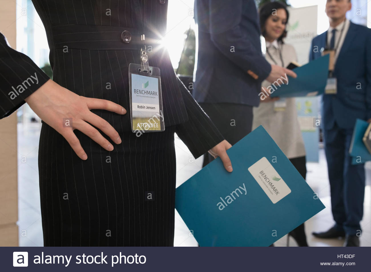 Close up businesswoman wearing identification badge at conference - Stock Image