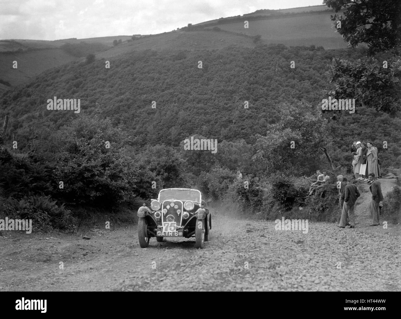 Singer sports competing in the Mid Surrey AC Barnstaple Trial, Beggars Roost, Devon, 1934. Artist: Bill Brunell. - Stock Image