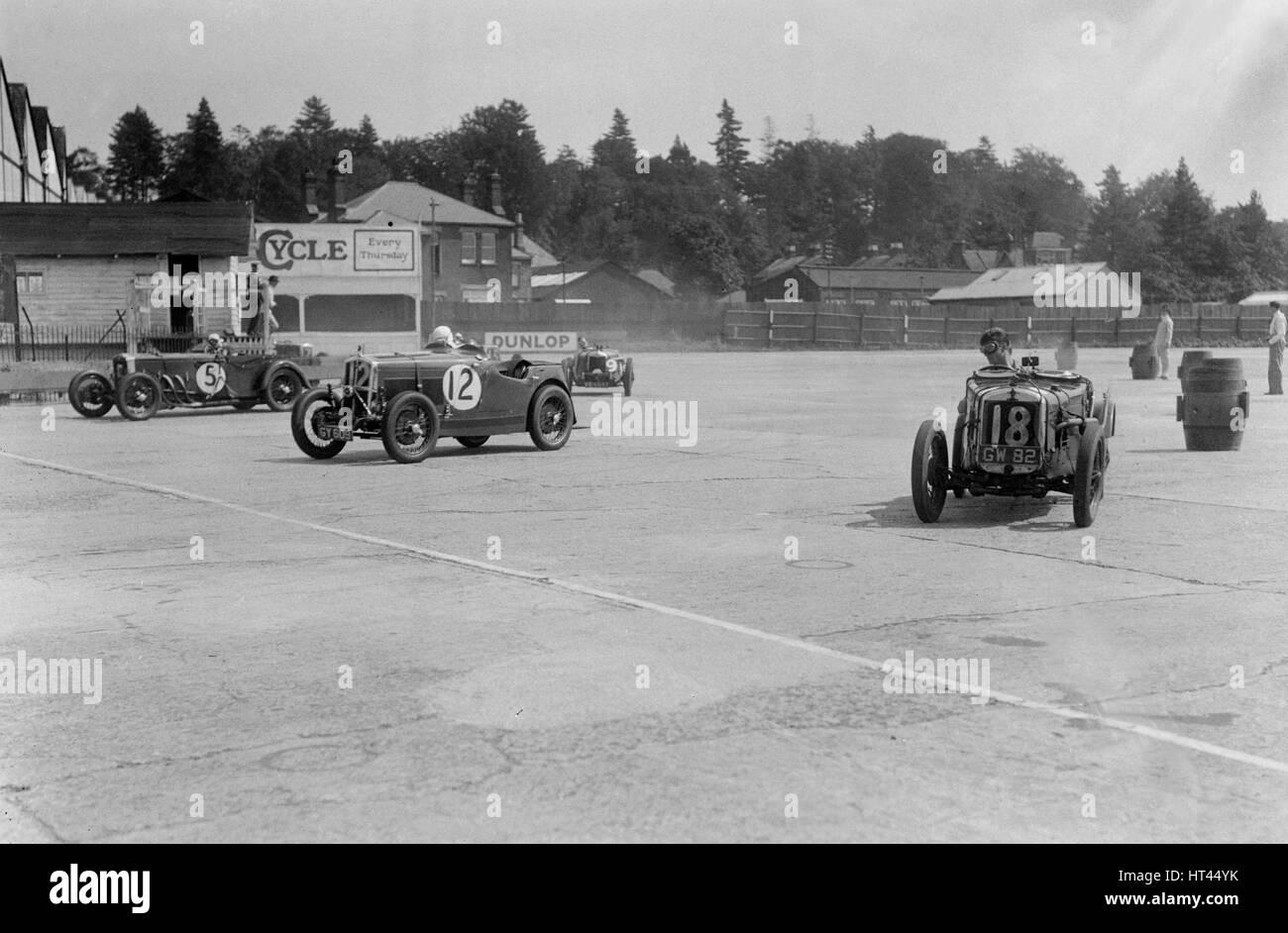 Frazer-Nash, Wolseley Hornet and Riley 9 Brooklands, BARC meeting, Brooklands, Surrey, 1933. Artist: Bill Brunell. - Stock Image