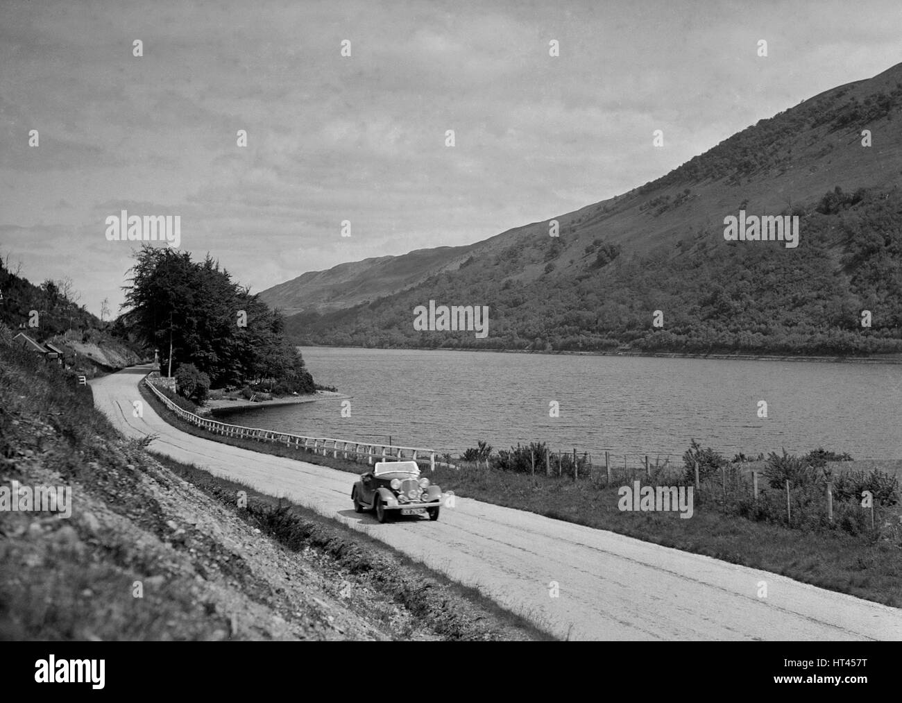 Rover competing in the RSAC Scottish Rally, 1936. Artist: Bill Brunell. - Stock Image