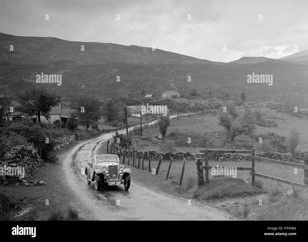Singer Nine Sports of Miss MC Sherer competing in the RSAC Scottish Rally, 1936. Artist: Bill Brunell. - Stock Image
