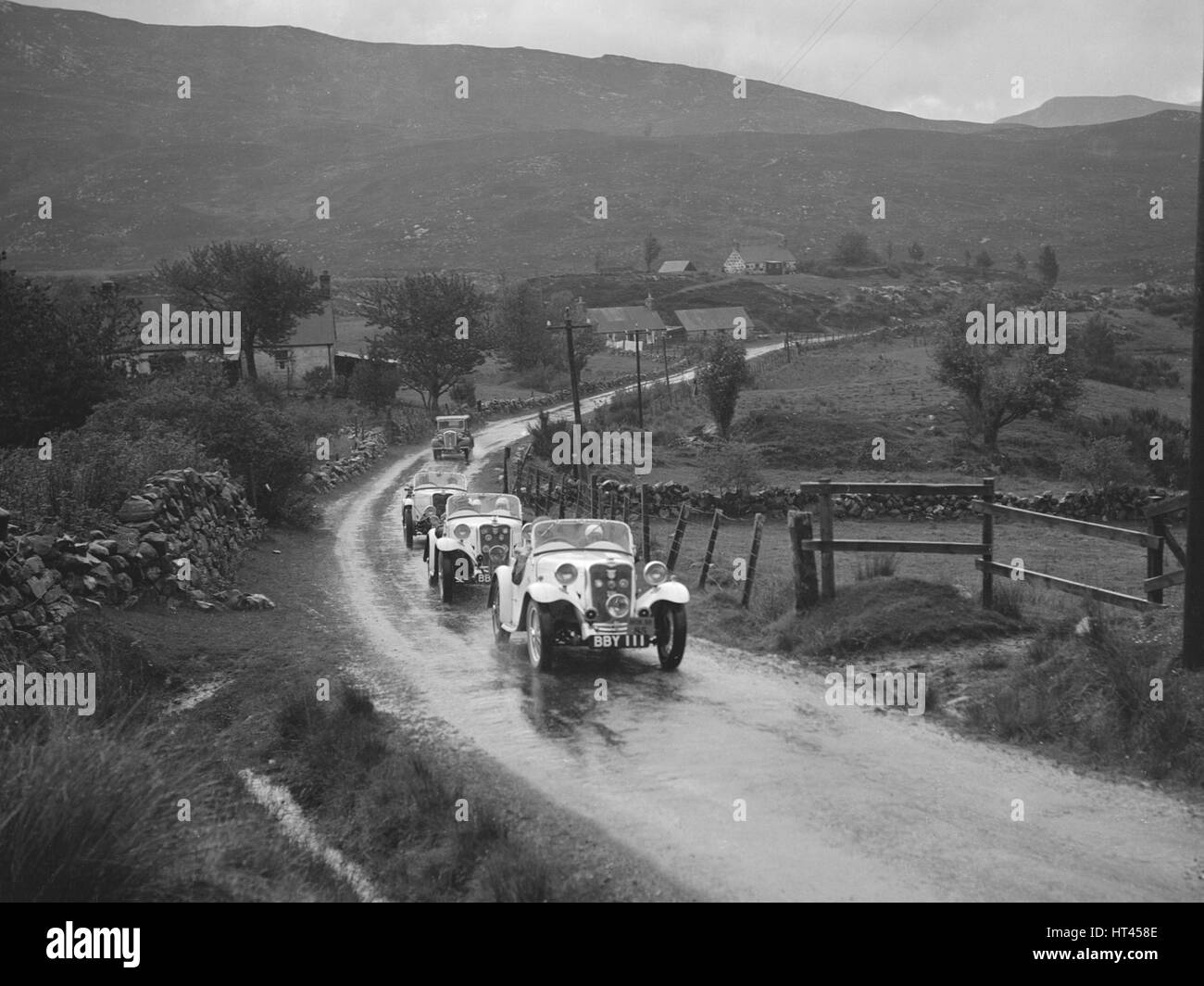 Two Singer Le Mans cars competing in the RSAC Scottish Rally, 1936. Artist: Bill Brunell. - Stock Image