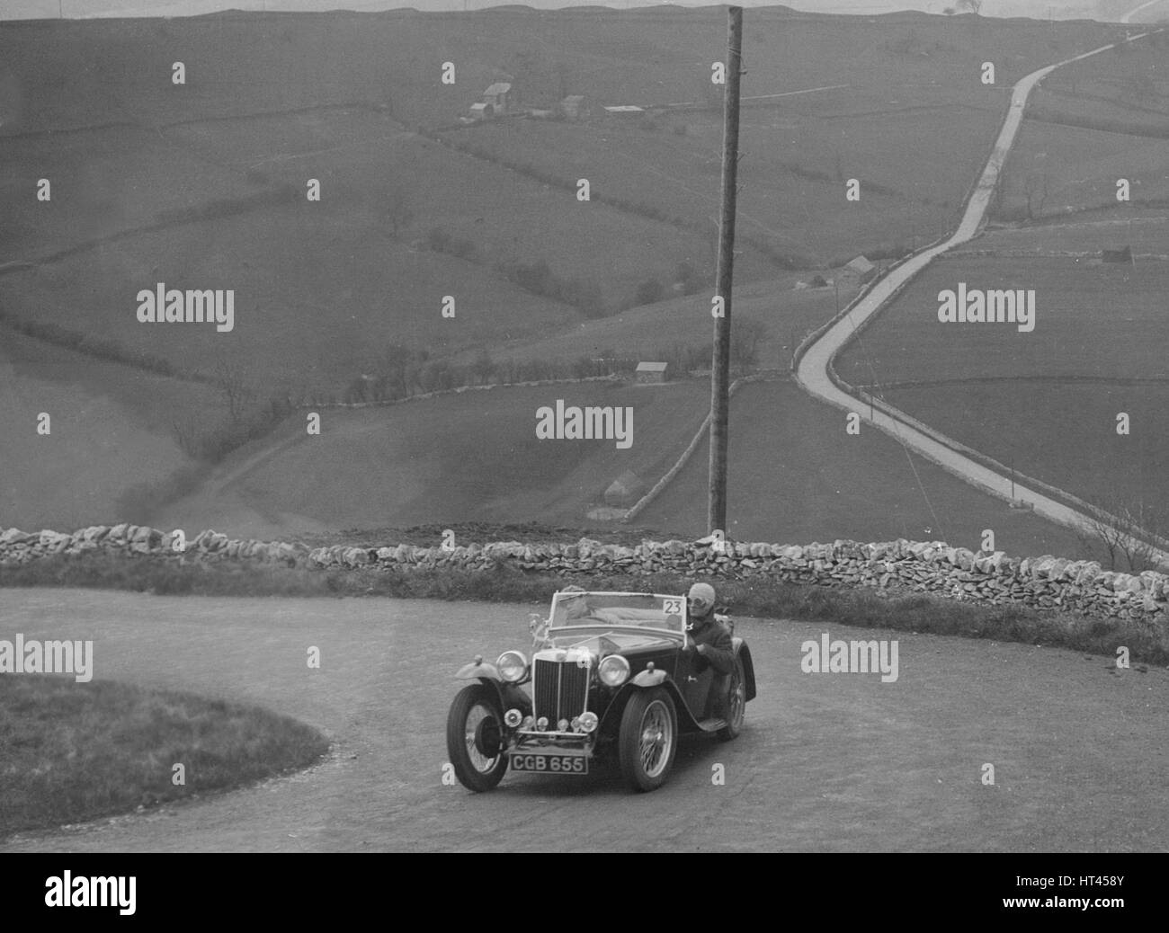 MG TA of WC Reid competing in the RAC Rally, 1939. Artist: Bill Brunell. - Stock Image