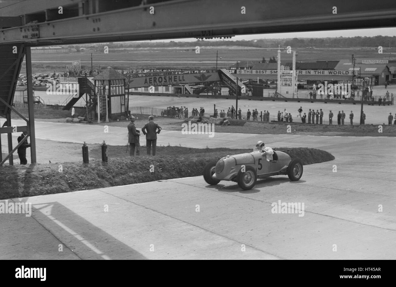 MG K3 of JHT Smith racing at Brooklands, Surrey, c1930s. Artist: Bill Brunell. - Stock Image