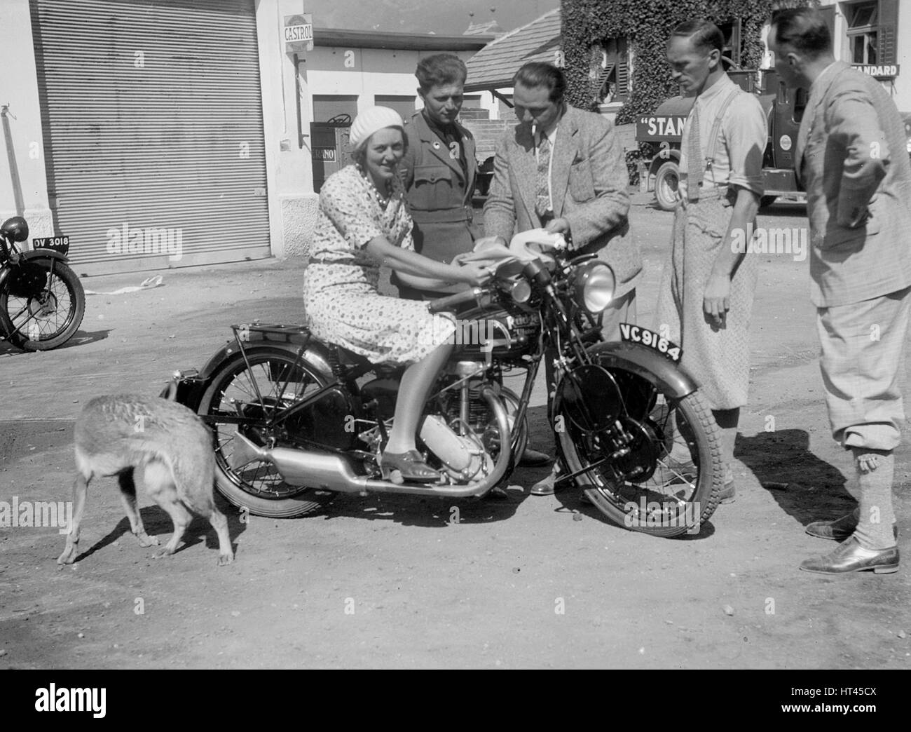 Betty Lemitte on a 499 cc Rudge Ulster motorcycle, 1930s. Artist: Bill Brunell. - Stock Image