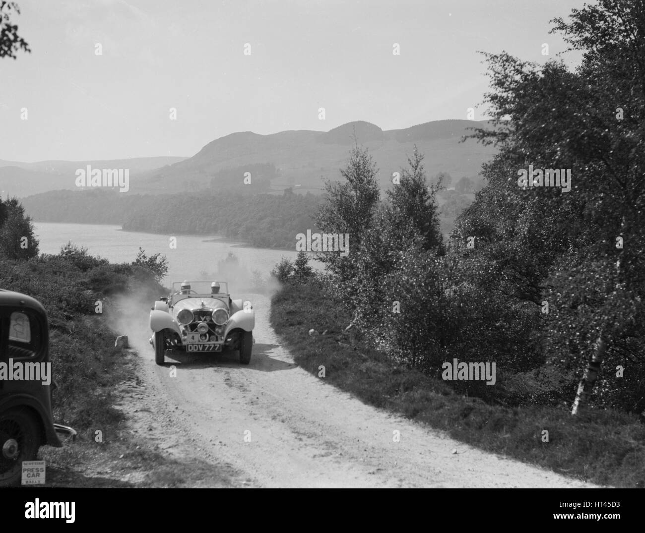 SS Jaguar 100 open 2-seater of Miss E Violet Watson competing in the RSAC Scottish Rally, 1939. Artist: Bill Brunell. - Stock Image
