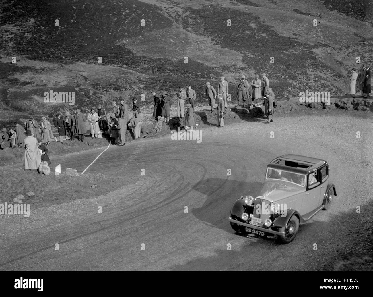 Rover 4-door saloon of WA Gilmour at the RSAC Scottish Rally, Devil's Elbow, Glenshee, 1934. Artist: Bill Brunell. - Stock Image