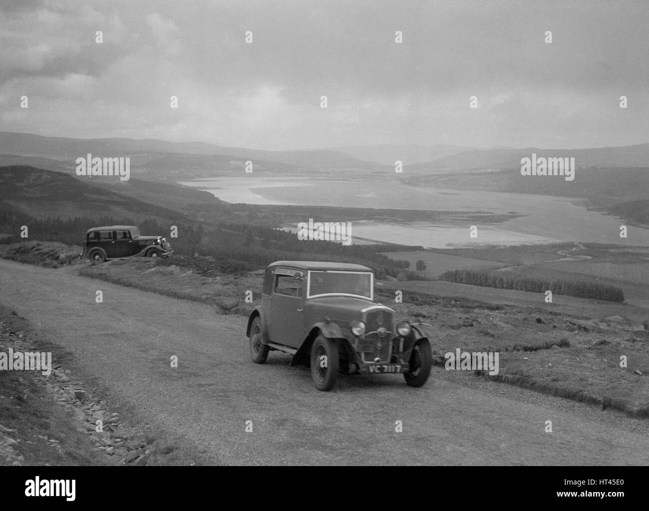 Rover coupe of G Ross competing in the RSAC Scottish Rally, 1934. Artist: Bill Brunell. - Stock Image