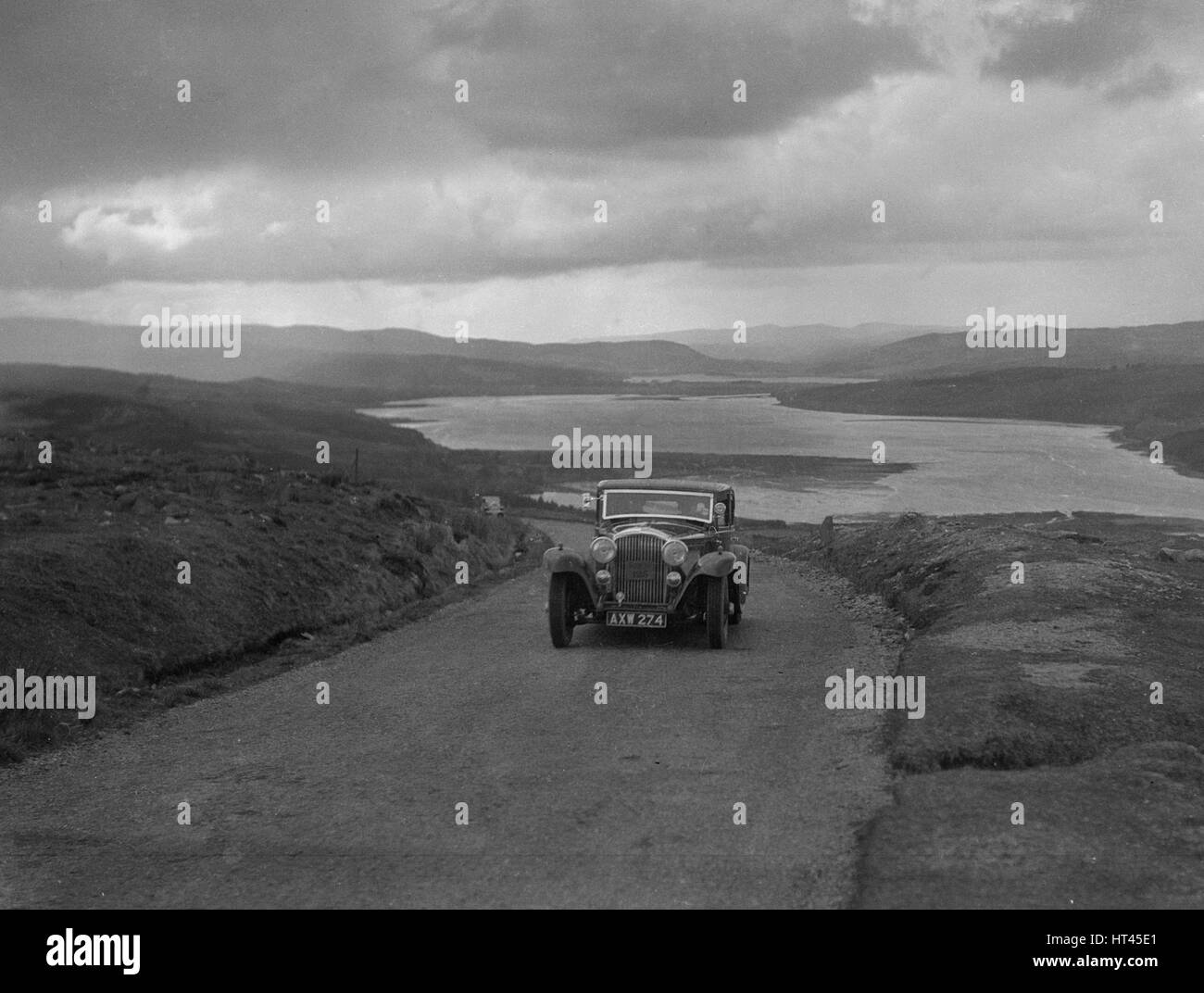Bentley saloon of SK Thornley competing in the RSAC Scottish Rally, 1934. Artist: Bill Brunell. - Stock Image