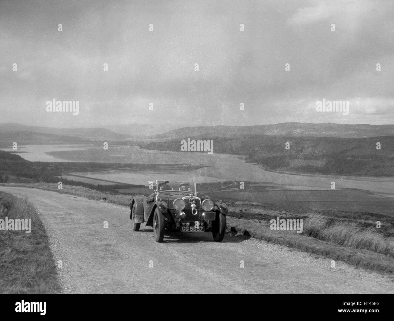 Alvis Speed Twenty tourer of I Fraser-Marshall competing in the RSAC Scottish Rally, 1934. Artist: Bill Brunell. - Stock Image
