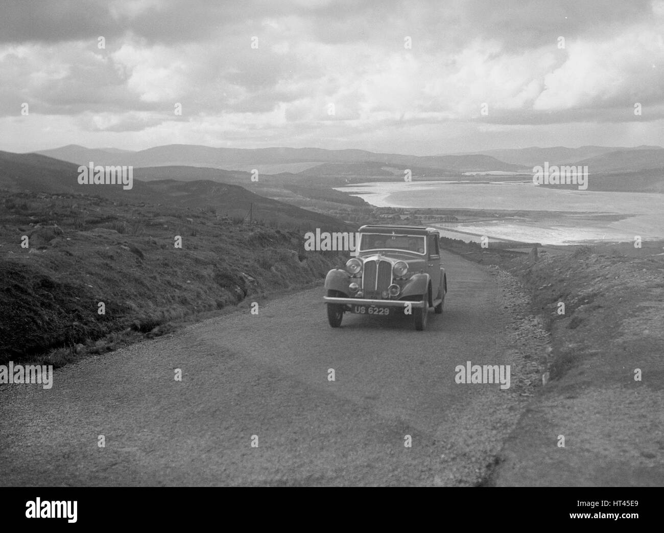 Rover saloon of J Gibbon Jr competing in the RSAC Scottish Rally, 1934. Artist: Bill Brunell. - Stock Image