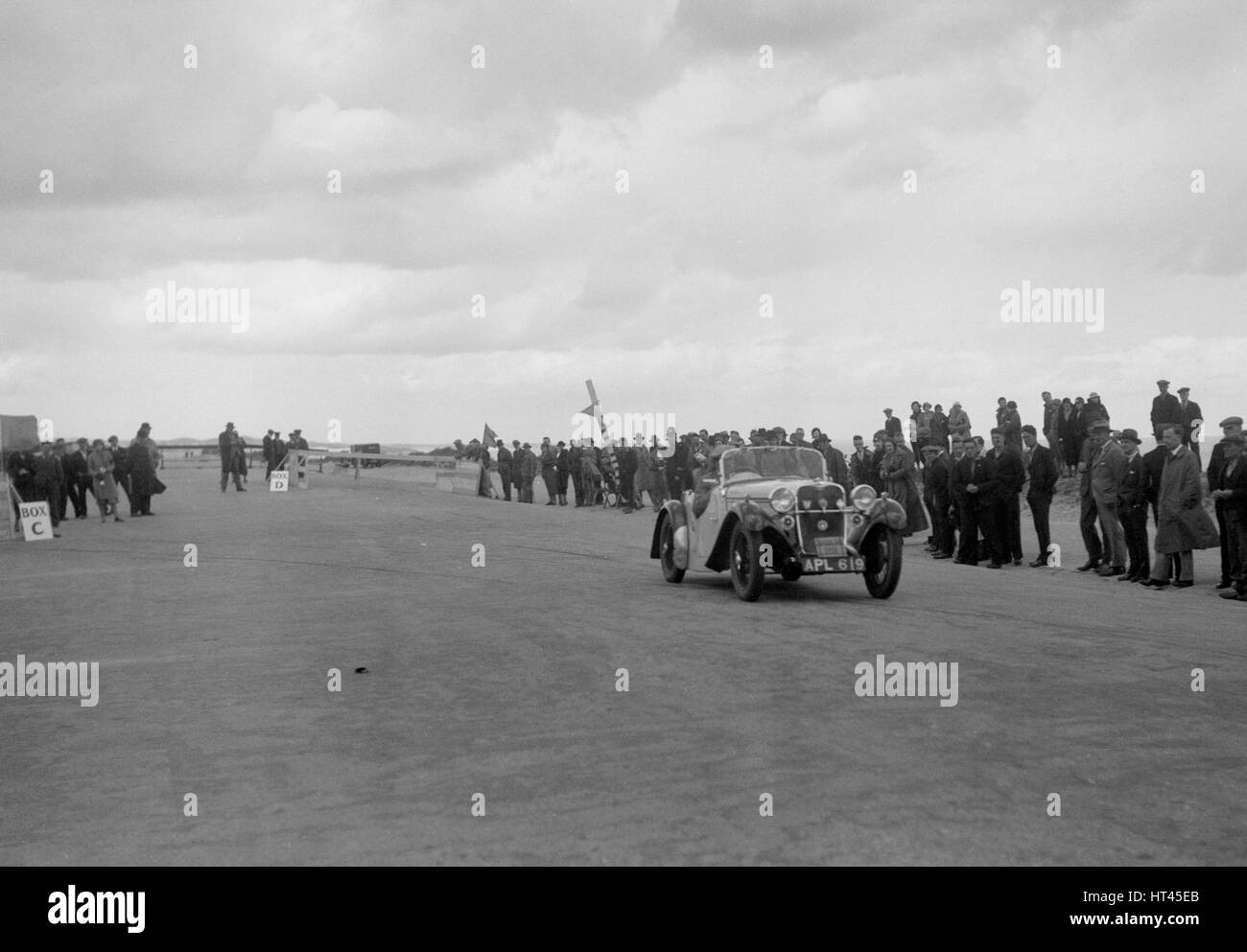 Singer open sports competing in the RSAC Scottish Rally, 1934. Artist: Bill Brunell. - Stock Image