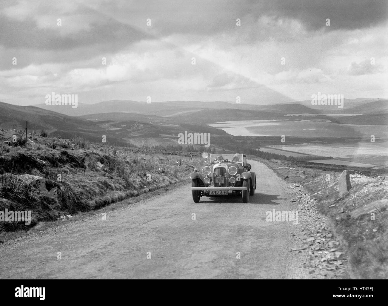 Lagonda open tourer of CG Seddon competing in the RSAC Scottish Rally, 1934. Artist: Bill Brunell. - Stock Image