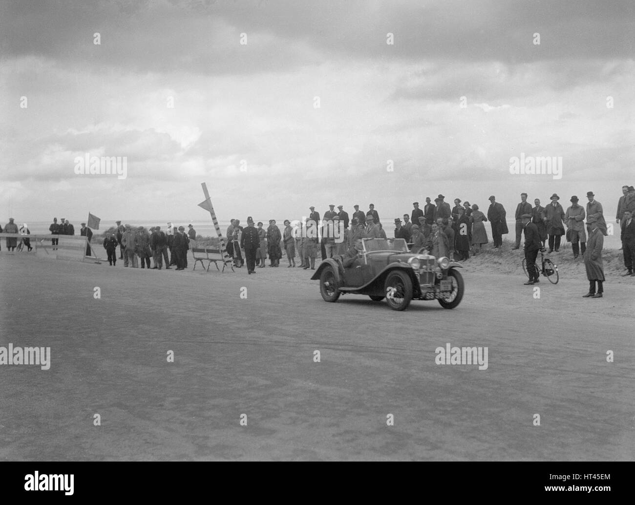 MG PA 2-seater sports competing in the RSAC Scottish Rally, 1934. Artist: Bill Brunell. - Stock Image