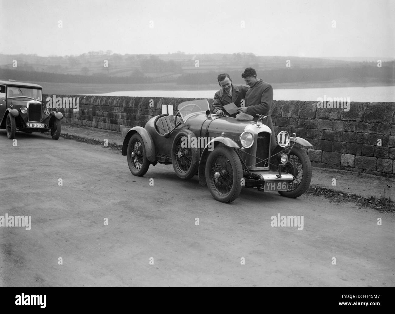 Amilcar and Riley 9 at the Ilkley & District Motor Club Trial, Fewston Reservoir, Yorkshire, 1930s. Artist: - Stock Image