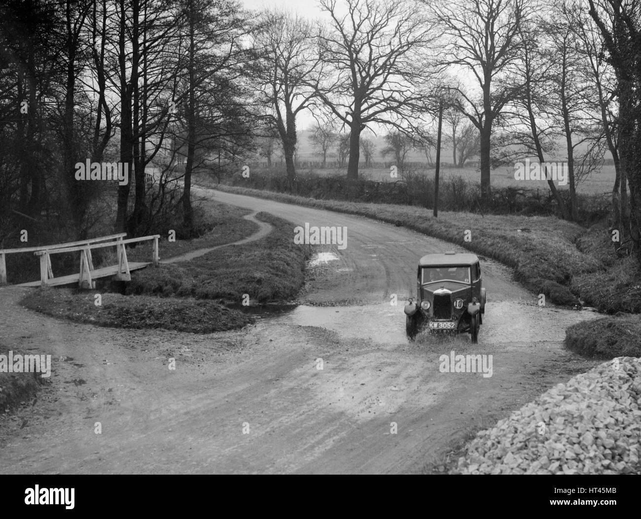 Riley 9 of HC Holm competing in the Ilkley & District Motor Club Trial, Yorkshire, 1930s. Artist: Bill Brunell. - Stock Image