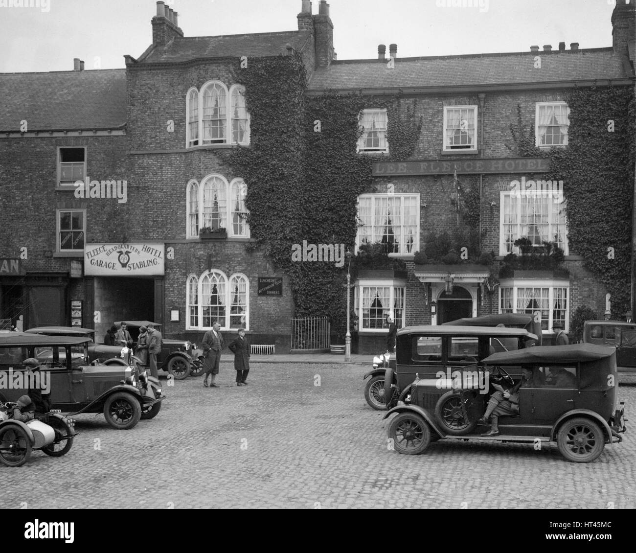 Cars parked outside the Fleece Hotel, Thirsk, Yorkshire, Ilkley & District Motor Club Trial, 1930s. Artist: - Stock Image