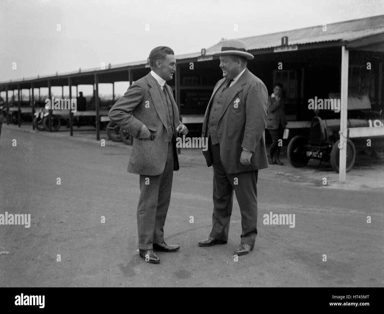 Two men chatting at Brooklands motor racing circuit, Surrey, 1920s. Artist: Bill Brunell. - Stock Image