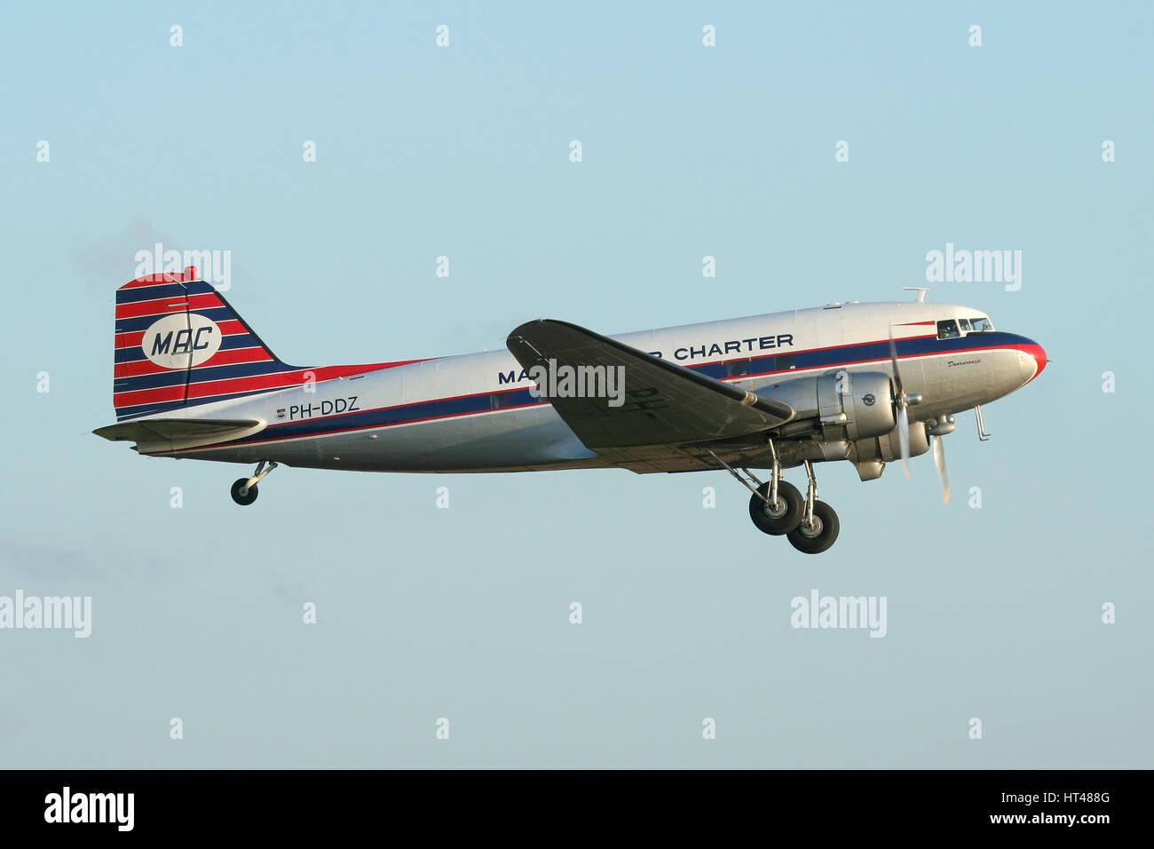 The Dutch Dakota Associations DC-3 Dakota departing Duxford after a air show and returning to Holland with Dutch Stock Photo
