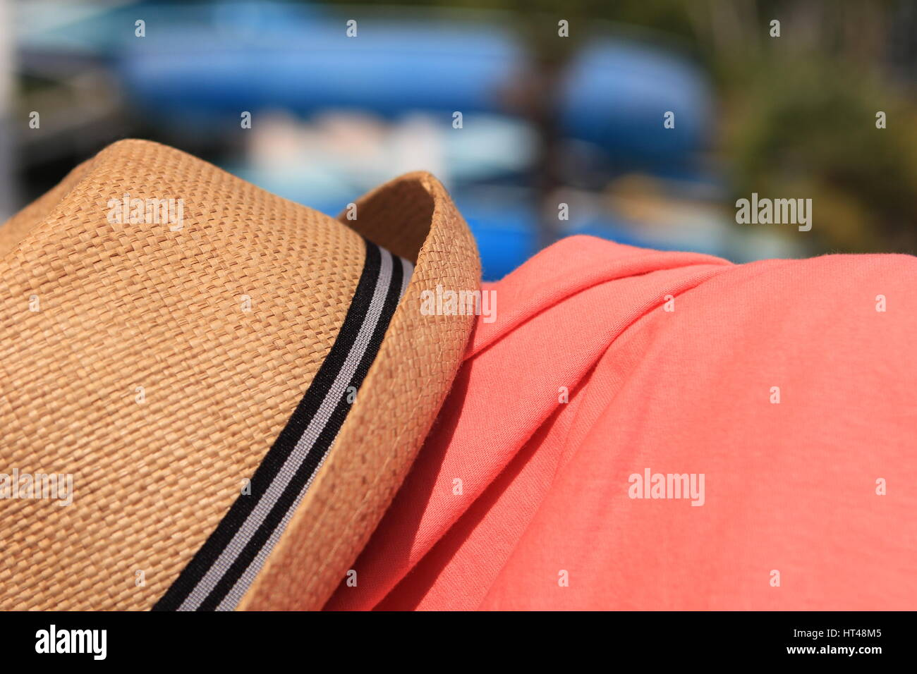 2f8aea15 Straw trilby hat on sunny pool side with pink shirt Stock Photo ...