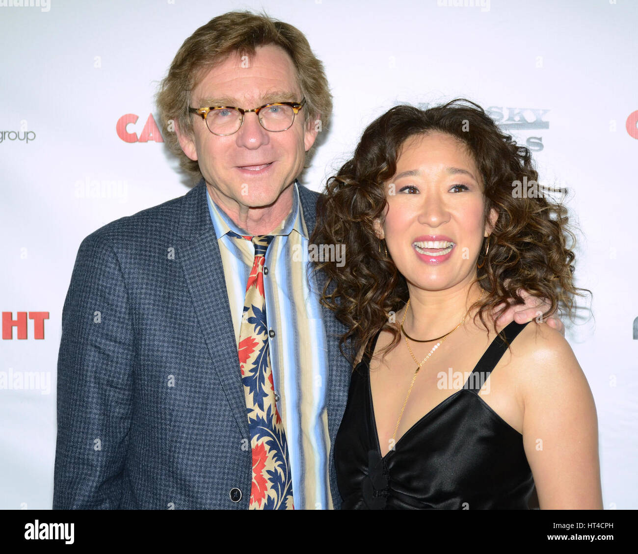 Jim Turner and Sandra Oh attends the premiere of Dark Sky Films' 'Catfight' at Cinefamily on March 2, - Stock Image