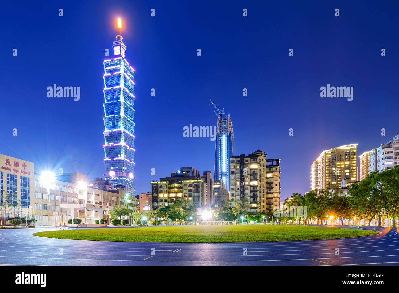 TAIPEI, TAIWAN - JANUARY 01: This is a night view of Taipei 101 and Xinyi financial district apartments and buildings - Stock Image