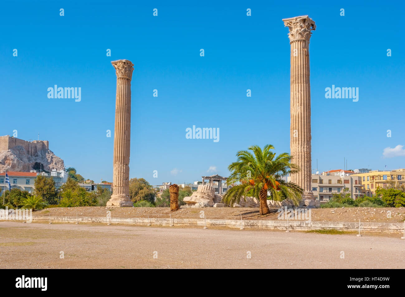 The antique columns are remainings of the ancient Temple of Olympian Zeus, Athens, Greece - Stock Image