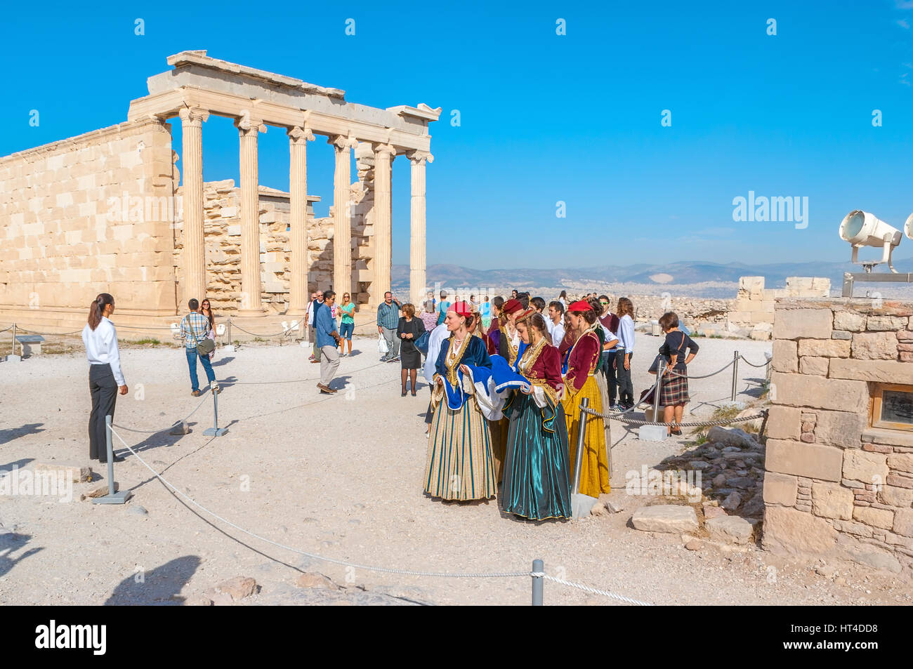 ATHENS, GREECE - OCTOBER 12, 2013: The women in national Greek costumes on teritory of Parthenon next to the Erechtheion, Stock Photo