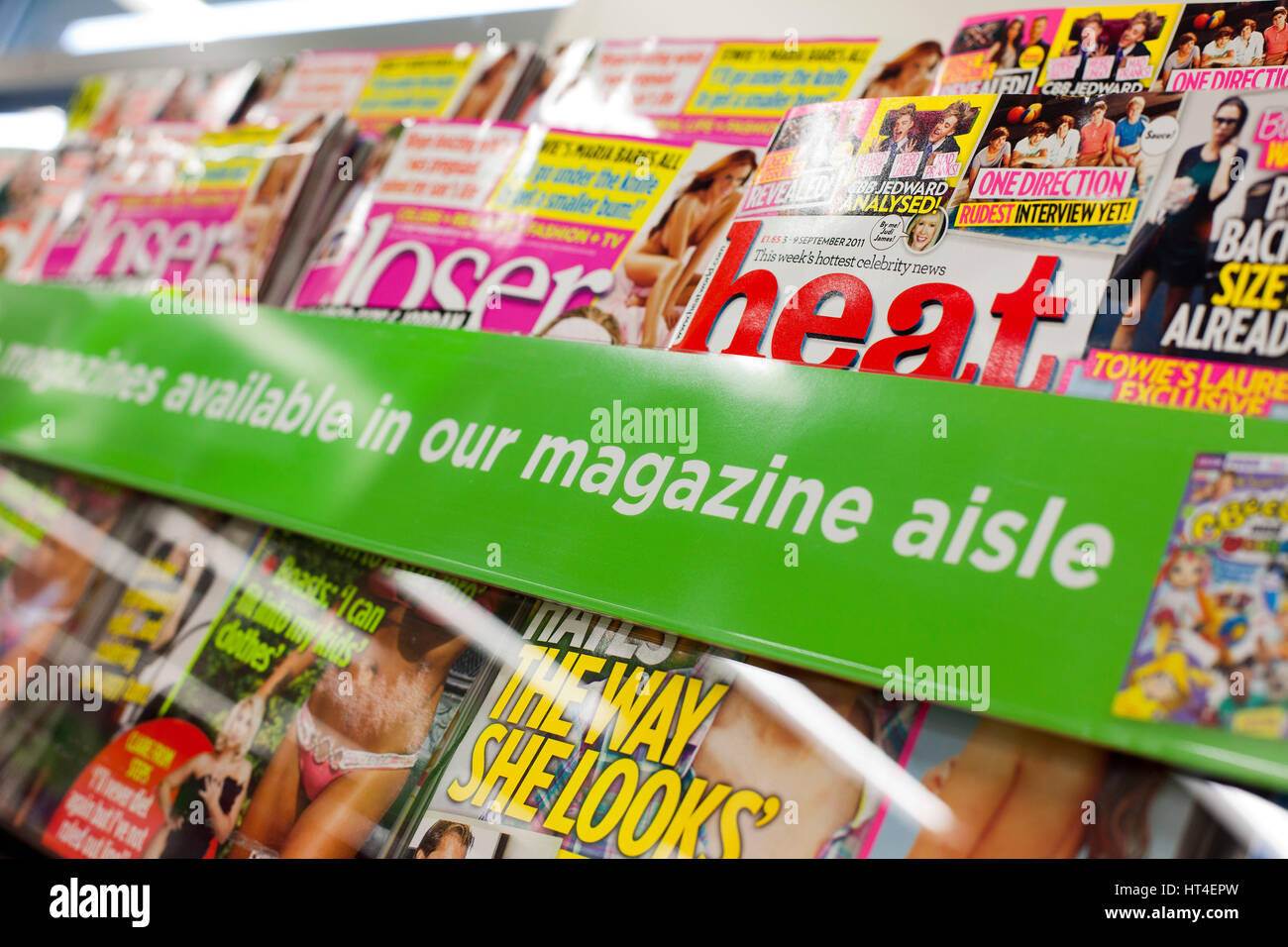 Heat and Closer magazines for sale in a supermarket - Stock Image