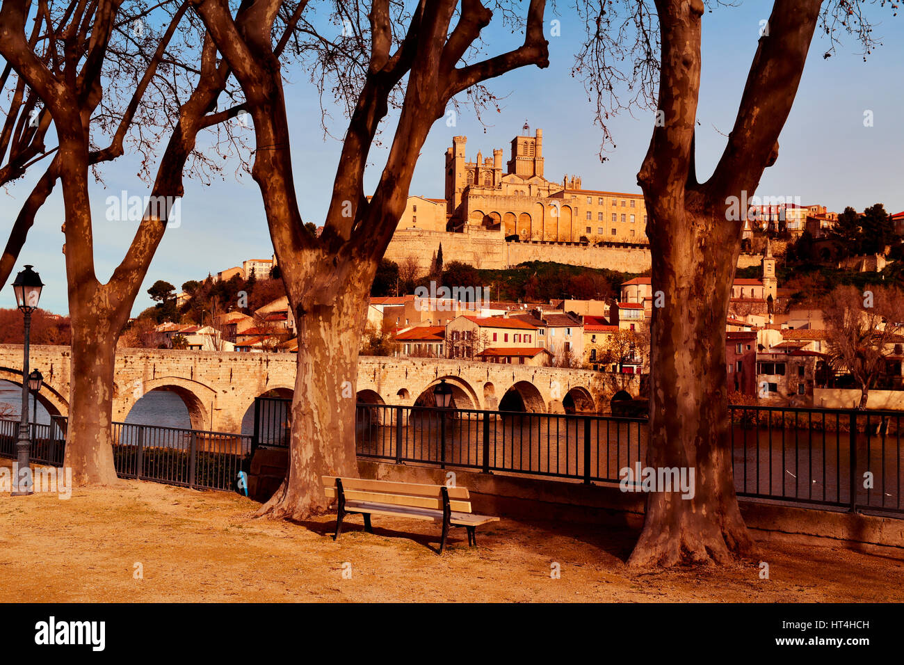 a view of the Pont Vieux bridge above the Orb River in Beziers, France, with the Old Town on the right, highlighting - Stock Image