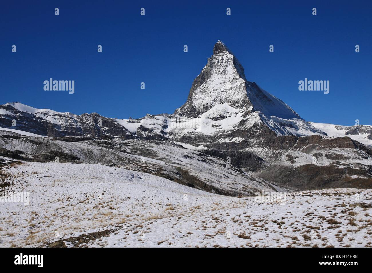 Matterhorn covered by new snow. Autumn scene in Zermatt. - Stock Image
