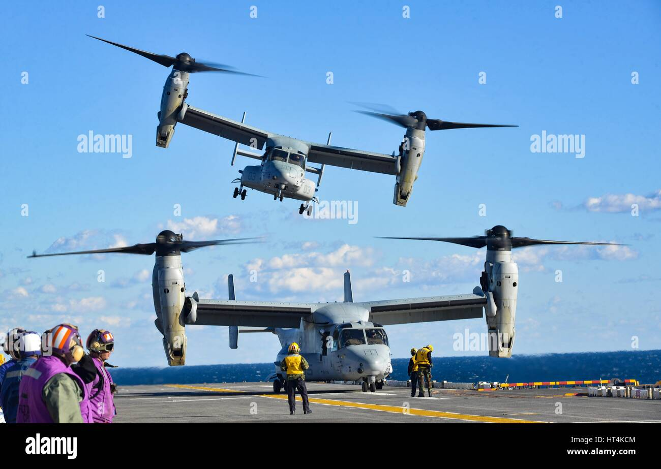 A U.S. Marine Corps MV-22 Osprey aircraft launches from the flight deck aboard the USN Wasp-class amphibious assault Stock Photo