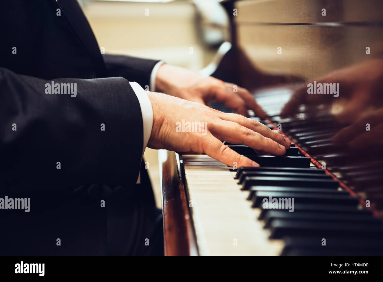 Playing classic piano. Professional musician pianist hands on piano keys. - Stock Image