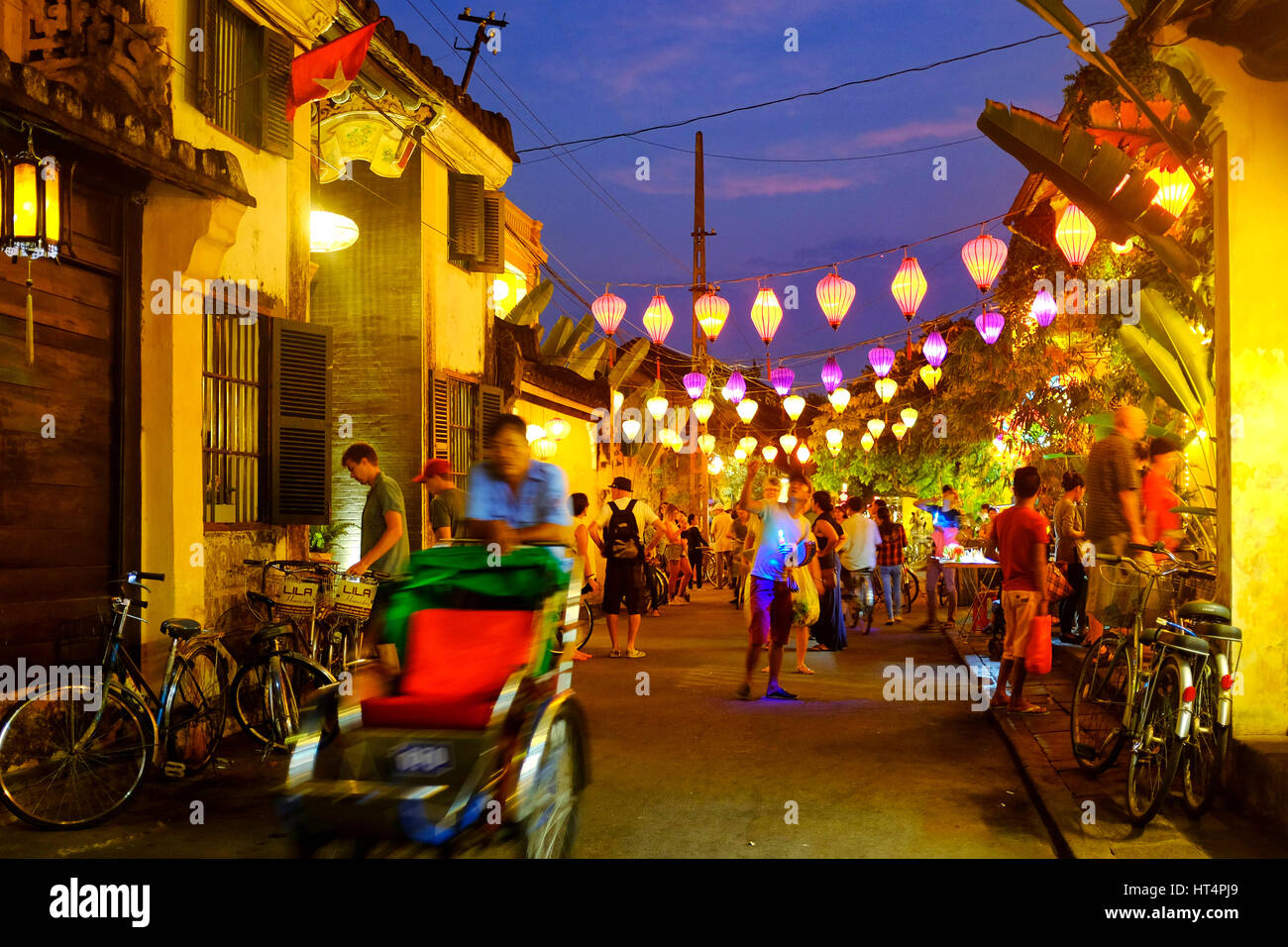 Locals and tourist in Tran Phu street at night, Hoi An, Vietnam Stock Photo