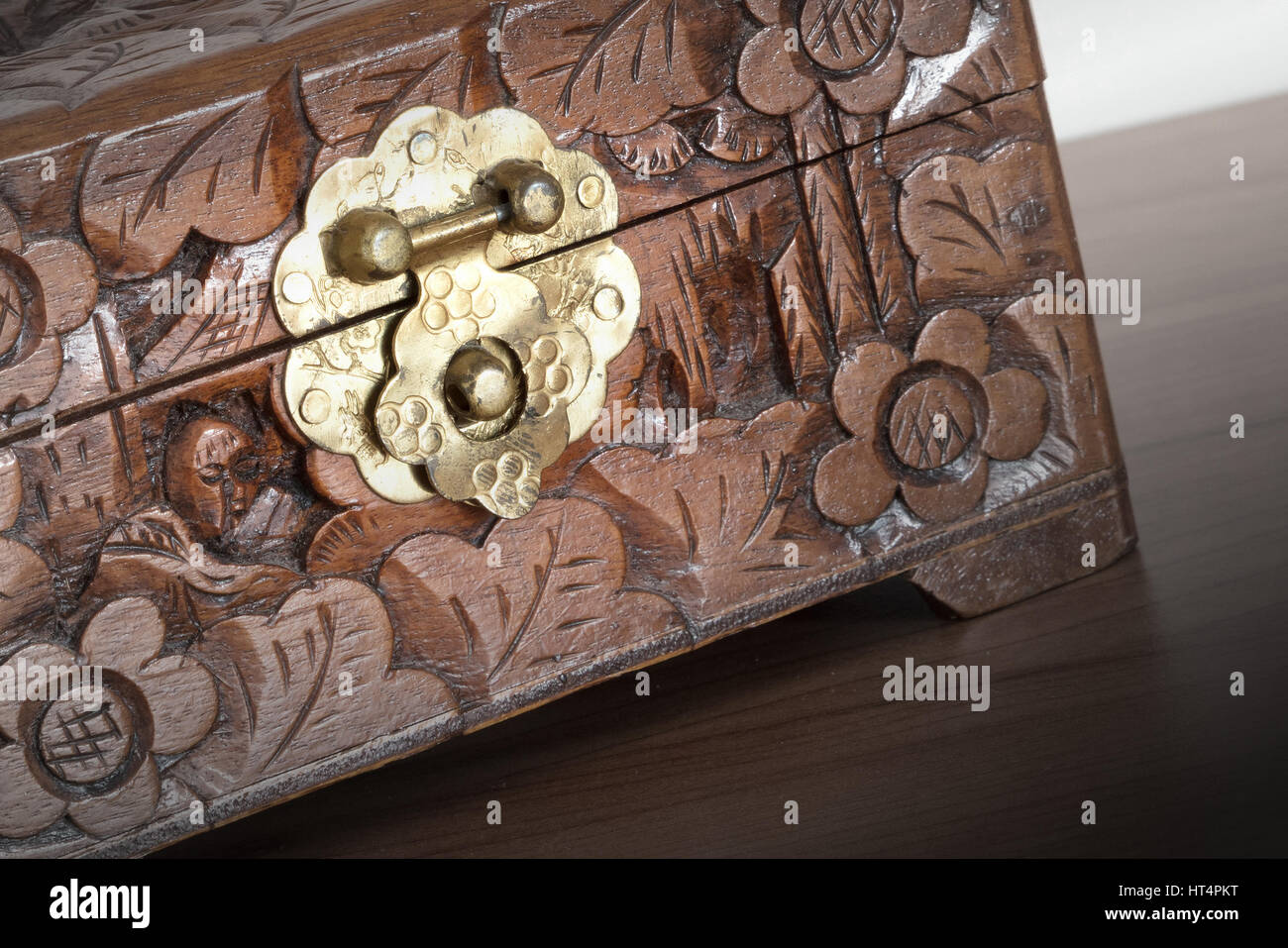 Very old wooden chest with simple lock selective focus stock