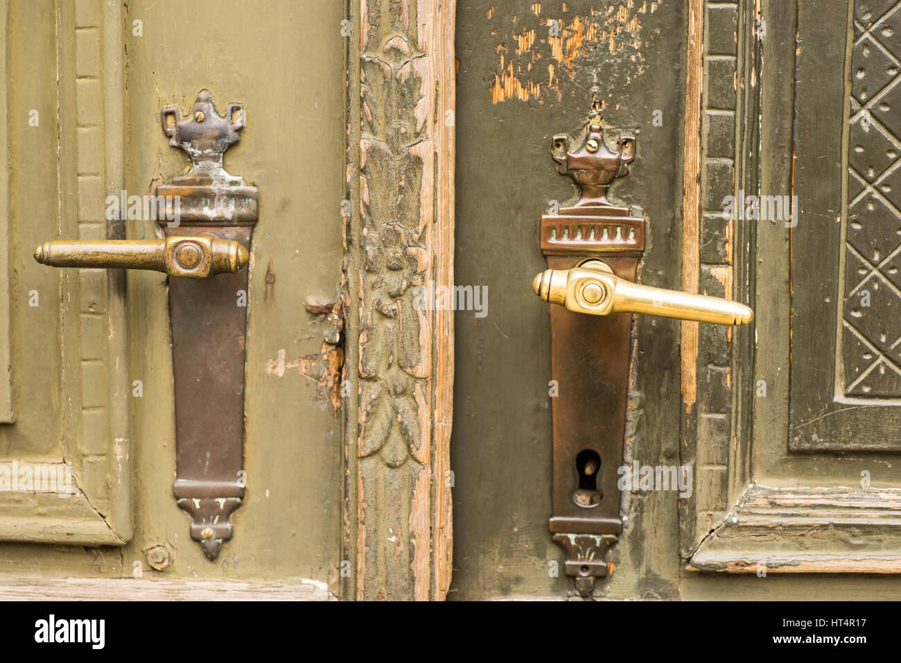 Brass door handles on elegant vintage green painted front door Stock ...