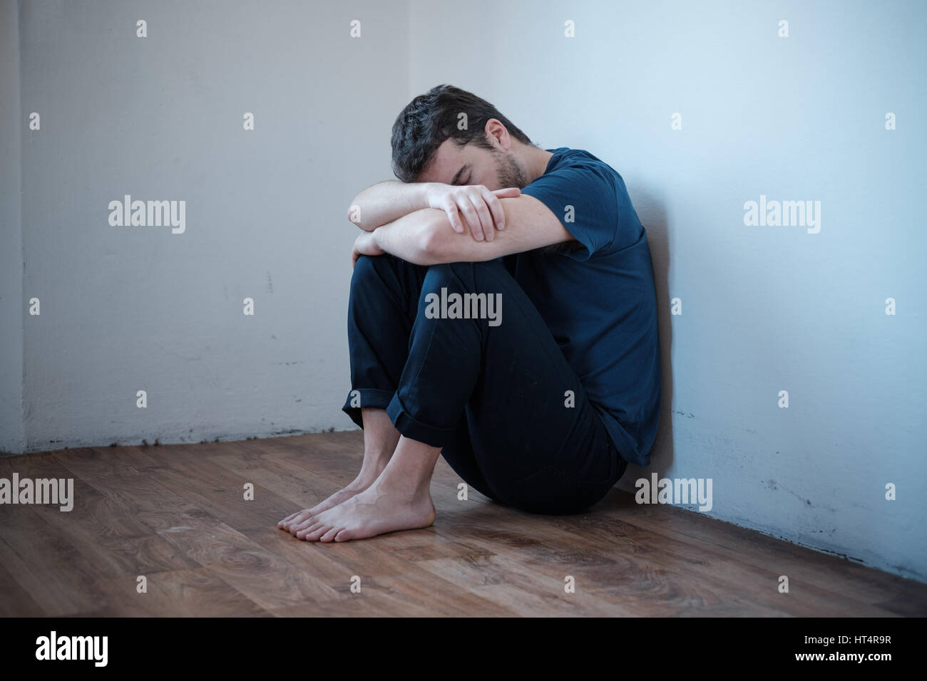 Desperate man in trouble feeling alone and depressed - Stock Image